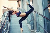 Portrait Of Beautiful Strong Woman In Sportwear Doing Workout Yoga Exercise And Stretching On The St poster