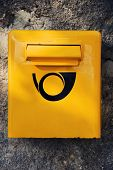 Yellow letter post box
