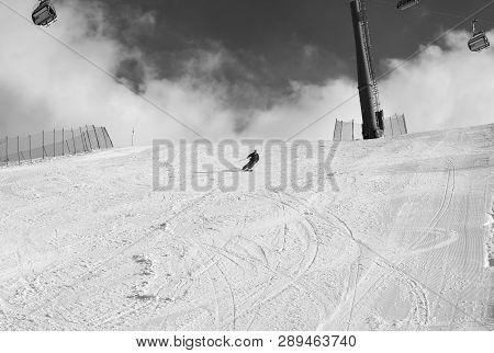 Skier Downhill On Snowy Ski
