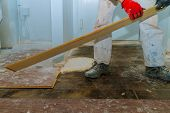 Demolish Of Old Wooden Parquet Floor With House Improvement Renovation poster