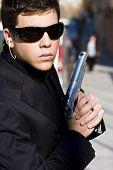 Alertness secret agent ready for action over urban background