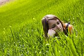 Young slept woman trough the grass
