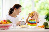 Mother Feeding Child. Mom Feeds Kid Vegetables poster
