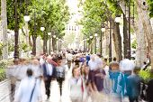 stock photo of street-walker  - Blurred crowd in the street - JPG