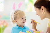 Mother And Kids, Family Coloring Easter Eggs. poster