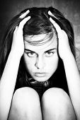 Tormented woman portrait in black and white.