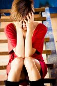 image of upskirt  - Beautiful blond woman covering her face with her hands - JPG
