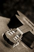 Guitar in perspective, soft focused in green background.