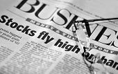 Stocks Fly High - Upbeat Headlines in a newspaper as wall street continues to see-saw from day to da