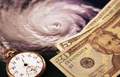 The inevitability of hurricane costs - money, watch, Katrina (via NASA public domain imagery)