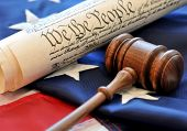 American Beginnings - gavel, US constitution, and flag