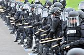 Protective line - police officers form a line in riot gear
