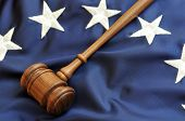 American Justice - gavel atop stars and blue portion of flag.