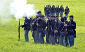 VISTA, CA - MAR 7: Union Army soldiers fire at the enemy during a Civil War reenactment on March 7,