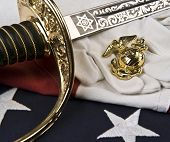 US Marine Corps symbols - flag, insignia, saber, and white gloves