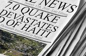 Newspaper says '7.0 Earthquake Devastates Haiti' - small Image is in the US public domain and taken by U.S. Coast Guard photo by Petty Officer 2nd Class Sondra-Kay Kneen.