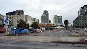 SAN DIEGO, CALIFORNIA - APRIL 4: Several tents in a public parking lot are home to a few of the over