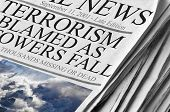 Newspaper headlines 'Terrorism Blamed As Towers Fall' on September 11, 2001 (NEWSPAPER IS FABRICATED