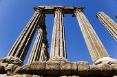 Ancient roman ruins over the blue sky.