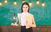 Biology Concept. Lady In Formal Wear On Calm Face In Classroom. Lady Scientist Holds Book And Micros poster