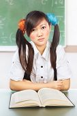 Ner Chinese female student in classroom doing stupid pose