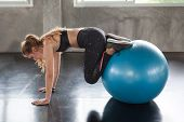 Young Fitness Woman In Sportswear Exercising With Pilates Ball In Gym . Sport Girl Workout Healthy L poster