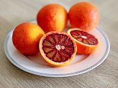 Still Life Of Oranges In The Plate - Tarocco Blood Orange - Sanguine Orange - Red Orange poster