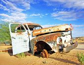 picture of junk-yard  - Wreck of an old car in a field - JPG