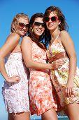 Three young woman enjoying summer