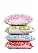 Red, blue, green and pink cushions stacked up on a pure white background with space for text