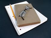 Notebook, Pencil, Glasses And Book