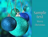 Colorful christmas baubles with space for text