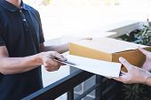 Delivery Mail Man Giving Parcel Box To Recipient And Signature Form, Young Owner Signing Receipt Of  poster