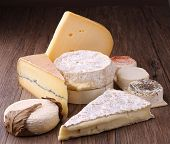 variation of cheese on wooden background