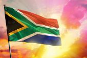 Fluttering South Africa Flag On Beautiful Colorful Sunset Or Sunrise Background. South Africa Succes poster