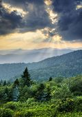 stock photo of blue ridge mountains  - Sunbeams Light Rays Over Southern Appalachian Blue Ridge Mountains at dramatic summer sunset - JPG
