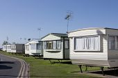 stock photo of caravan  - a row of static caravans on a typical british summer holiday park - JPG