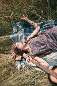 Young Hippie Woman Sleeping On Mowed Grass poster