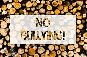 Handwriting Text No Bullying. Concept Meaning Forbidden Abuse Harassment Aggression Assault Wooden B poster