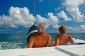Couple Sunbath On A Sail Boat