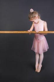 pic of ballet dancer  - Young ballet dancer wearing an apricot tutu - JPG