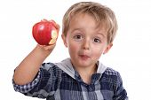 foto of little boys only  - Healthy eating childhood nutrition concept small boy eating a red apple - JPG