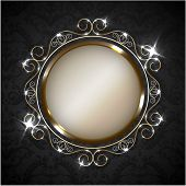 Golden ornate frame on decorated wallpaper