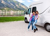 Happy young womans outside motorhome