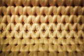 Golden leather luxury background close-up