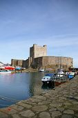 Carrickfergus Castle Showing Boats In Harbour