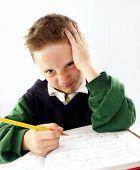 Little school kid on his desk.mixed race student.