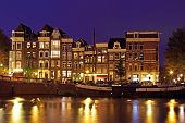 Medieval houses at the Amstel in Amsterdam the Netherlands at night