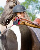 Horse riding - portrait of lovely equestrian