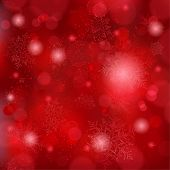 pic of christmas theme  - Snowflakes and blurry lights on dark red background - JPG